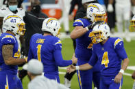 Los Angeles Chargers kicker Mike Badgley (4) celebrates his game-winning field goal with teammates during the second half of an NFL football game against the Atlanta Falcons Sunday, Dec. 13, 2020, in Inglewood, Calif. (AP Photo/Ashley Landis)
