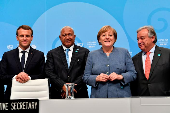 From left to right:French President Emmanuel Macron; prime minister of Fiji and president of COP 23 Frank Bainimarama; German Chancellor Angela Merkel; and UN Secretary-General Antonio Guterres. The leaders pose on Wednesday before the opening sessionof the United Nations' conference on climate change in Bonn, Germany. (Photo: JOHN MACDOUGALL via Getty Images)
