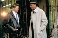 """<p>&gt;In this 1995 crime thriller, Pitt plays newly transferred detective David Mills, who works alongside retiring homicide detective William Somerset (played by <a class=""""link rapid-noclick-resp"""" href=""""https://www.popsugar.com/Morgan-Freeman"""" rel=""""nofollow noopener"""" target=""""_blank"""" data-ylk=""""slk:Morgan Freeman"""">Morgan Freeman</a>) to track down a serial killer whom they believe to be targeting people who have committed one of the Seven Deadly Sins (and killing them in a gruesome manner that represents that sin). </p> <p>Watch <a href=""""https://play.hbomax.com/page/urn:hbo:page:GX0_KAgpf77CttQEAAAJc:type:feature"""" class=""""link rapid-noclick-resp"""" rel=""""nofollow noopener"""" target=""""_blank"""" data-ylk=""""slk:Se7en""""><strong>Se7en</strong></a> on HBO Max now.</p>"""