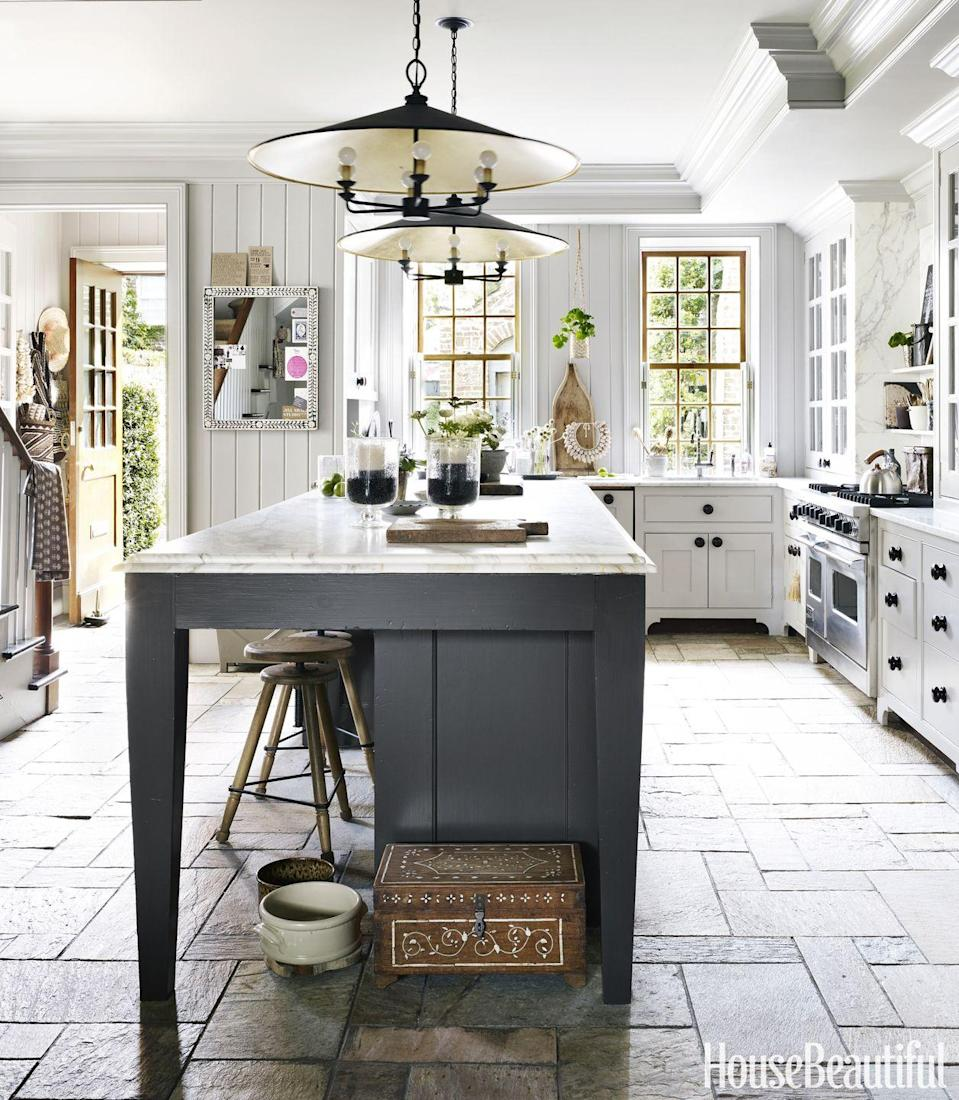 "<p>For an oversized island, like in this <a href=""https://www.housebeautiful.com/design-inspiration/house-tours/g3558/jill-sharp-weeks-charleston-rental-tour/"" rel=""nofollow noopener"" target=""_blank"" data-ylk=""slk:Charleston kitchen"" class=""link rapid-noclick-resp"">Charleston kitchen</a> by Jill sharp Weeks, you need statement lighting of the same scale and proportion .These iron pendants add drama and necessary light without being too over-the-top. </p>"