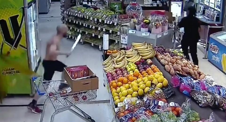 The shopper was shown running towards the alleged thief while holding a machete. Source: Nine News