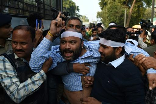 A demonstrator in Ahmedabad, Gujarat state, vents his anger at a protest against India' new citizenship law