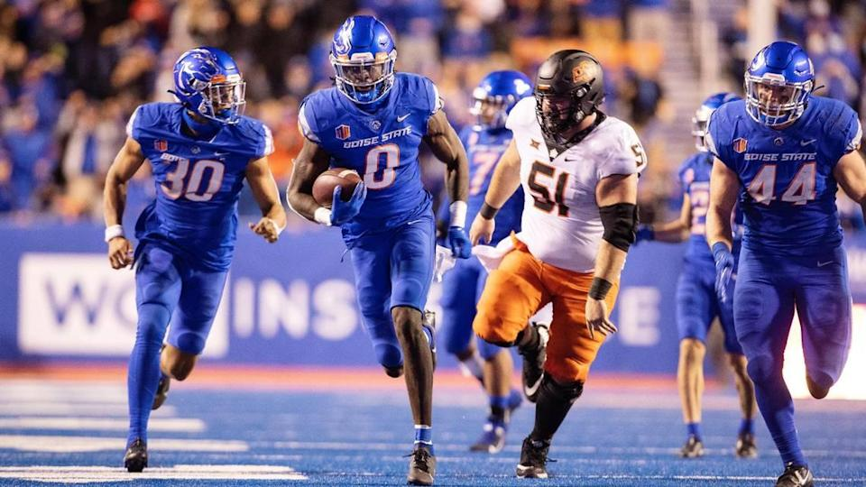 Late in the fourth quarter, Boise State safety JL Skinner runs for a touchdown after recovering a fumble on a play that was ultimately ruled dead. The ball was placed at the spot of the fumble.