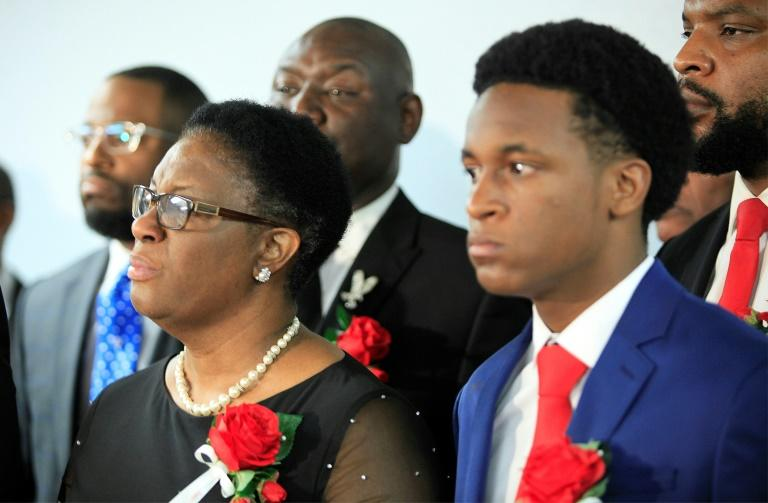 Botham Jean's mother Allison Jean, pictured with family after his funeral, looked upward and raised her arms as the verdict was delivered (AFP Photo/Stewart F. House)