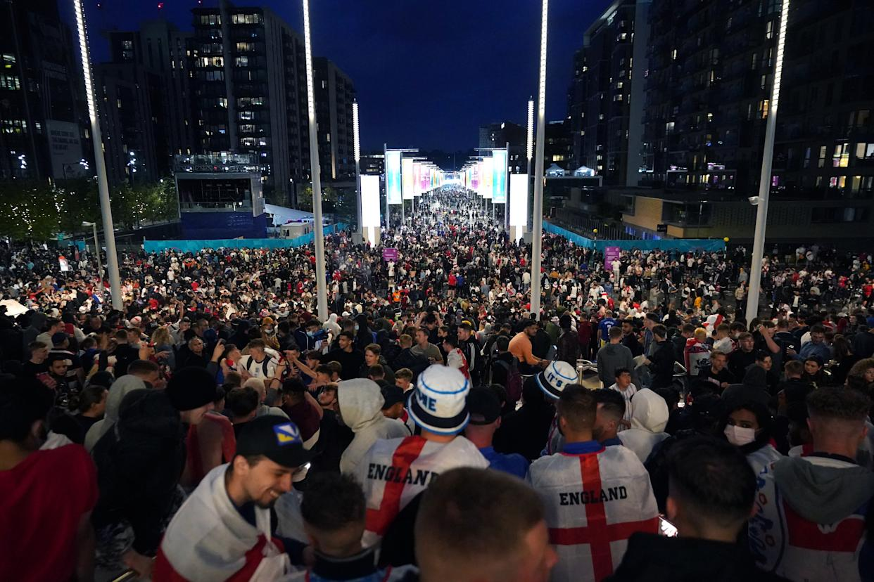 England fans outside the ground during the UEFA Euro 2020 Final at Wembley Stadium, London. Picture date: Sunday July 11, 2021.