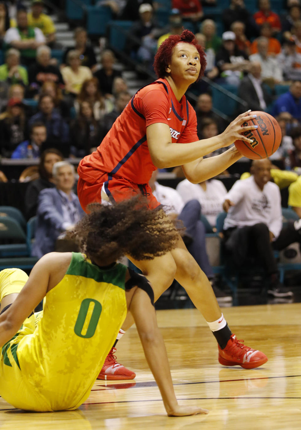 Arizona's Semaj Smith shoots over Oregon's Satou Sabally during the first half of an NCAA college basketball game at the Pac-12 women's tournament Friday, March 8, 2019, in Las Vegas. (AP Photo/John Locher)