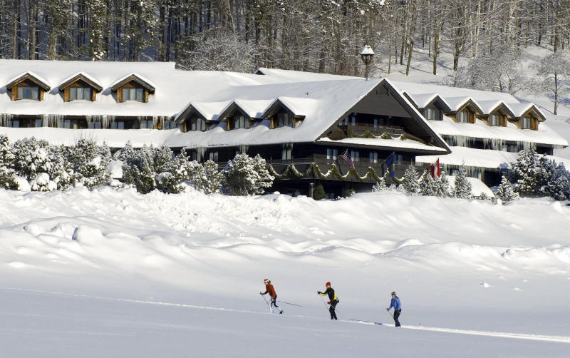 "FILE - This undated file photo provided by the Trapp Family Lodge shows cross-country skiers outside the lodge in Stowe, Vt. After a televised update of ""The Sound of Music"" on Dec. 5, 2013, the hills of Vermont were alive with phones ringing at the lodge. Three-quarters of a century after the singing family arrived from Austria, they're still in demand at the 96-room chalet style inn they started. The family moved to the spot in 1942 after visiting Vermont on a singing tour and vacationing in Stowe. (AP Photo/Trapp Family Lodge, File)"