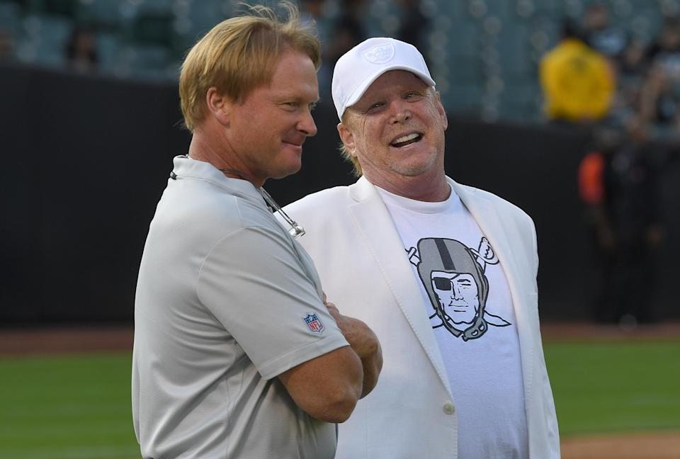 Mark Davis, right, has a big decision on where Jon Gruden will coach the Raiders next season. (Getty)