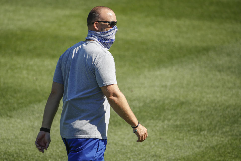Chicago Cubs manager David Ross walks on the field during baseball practice at Wrigley Field on Friday, July 3, 2020 in Chicago. (AP Photo/Kamil Krzaczynski)