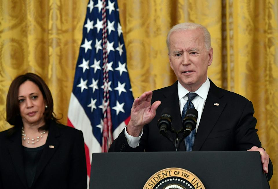 Vice President Kamala Harris listens as US President Joe Biden speaks before signing the Covid-19 Hate Crimes Act, in the East Room of the White House in Washington, DC on May 20, 2021. (Nicholas Kamm/AFP via Getty Images)