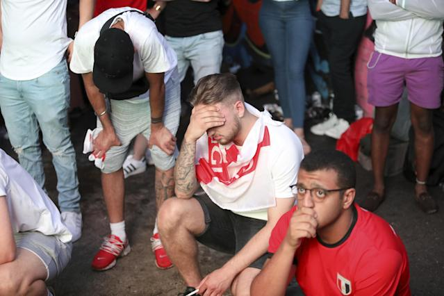 <p>A dejected England fan in Birmingham comes to terms with the Three Lions defeat. (SWNS) </p>