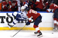 Tampa Bay Lightning center Anthony Cirelli (71) is sent to the boards while going for the puck against Florida Panthers left wing Mason Marchment (19) during the third period in Game 2 of an NHL hockey Stanley Cup first-round playoff series Tuesday, May 18, 2021, in Sunrise, Fla. (AP Photo/Lynne Sladky)