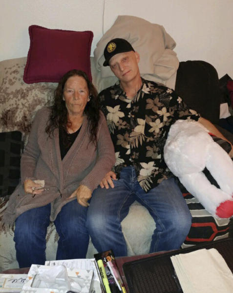 FILE - In this 2018, file photograph released by lawyer Mark Zaid, Michael R. White, right, is seen with his mother, Joanne White, left. Michael White, a Navy veteran detained in Iran for nearly two years, has been released and is on his way home as part of an unusual agreement to free an Iranian-American physician who was prosecuted in the United States, U.S. officials said Thursday, June 4, 2020. (White family via AP)