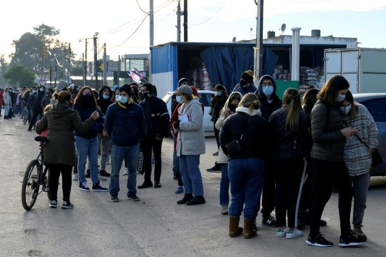 People queue to get a Covid-19 vaccination appointment in Paso de Carrasco, Uruguay on May 26, 2021
