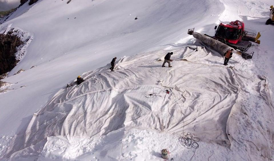 Employees place blankets on parts of the glacier to protect it against melting (REUTERS)