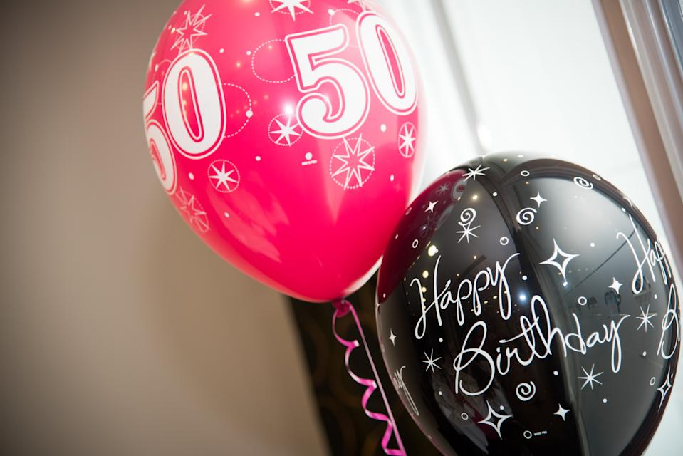 Red and black balloons for a 50th Birthday Party