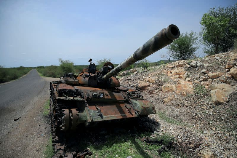 FILE PHOTO: A tank damaged during the fighting between Ethiopia's National Defense Force (ENDF) and Tigray Special Forces stands on the outskirts of Humera town