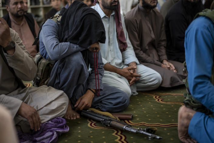 A member of the Taliban prays inside a mosque during Friday prayers in Kabul, Afghanistan, Friday, Sept. 17, 2021. (AP Photo/Bernat Armangue)