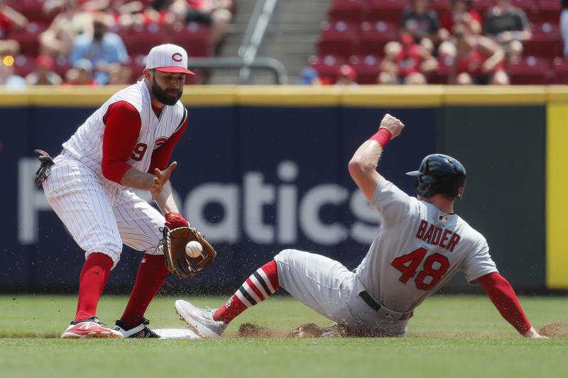 St. Louis Cardinals' Harrison Bader (48) slides into second against Cincinnati Reds second baseman Jose Peraza (9) in the second inning of a baseball game, Sunday, July 21, 2019, in Cincinnati. (AP Photo/John Minchillo)