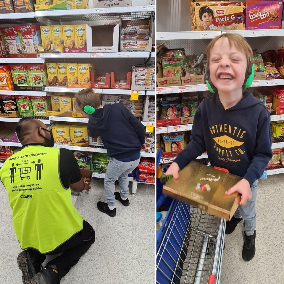 son helps coles staffer stack shelves and smiles with box of chocolates