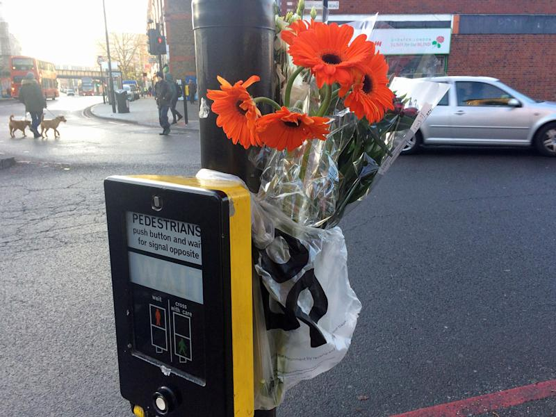 Flowers left at the scene for the woman in Tulse Hill, south London: PA