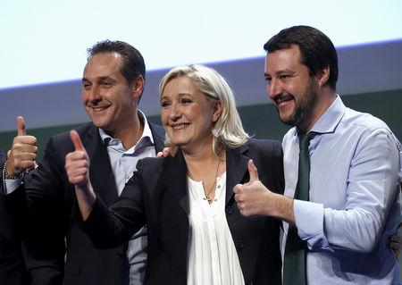 """FILE PHOTO: Far-right leaders Matteo Salvini, Marine Le Pen and Heinz-Christian Strache give a thumbs up at the end of the """"Europe of Nations and Freedom"""" meeting in Milan in 2016"""