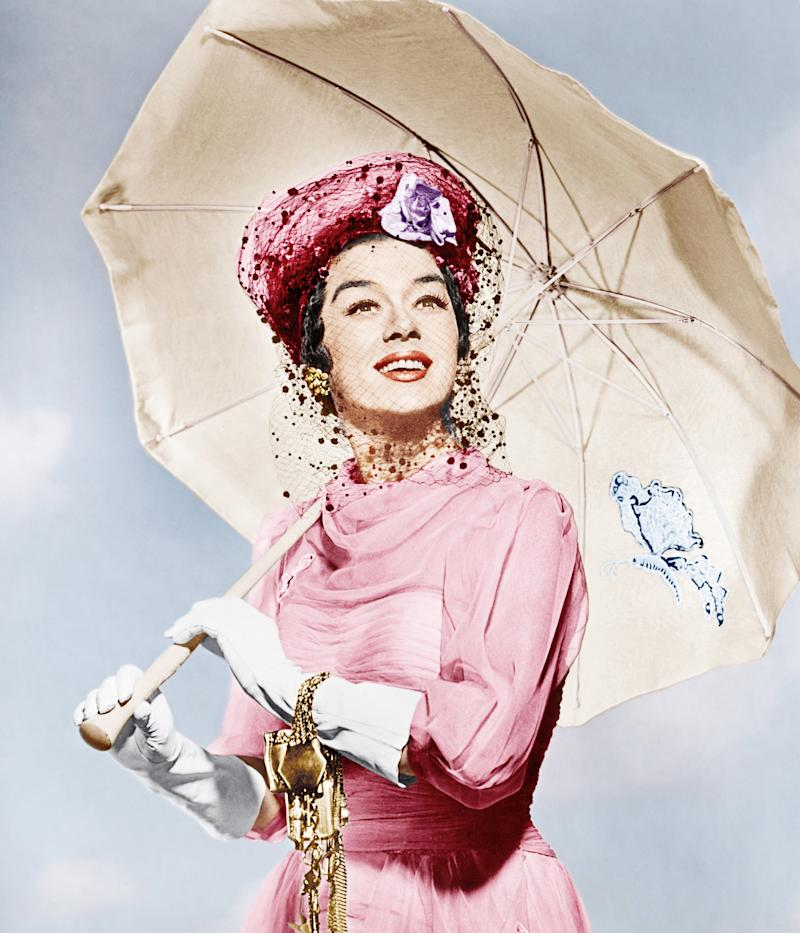 """Auntie Mame, 1958 Costume Designer: Orry-Kelly Auntie Mame's mantra is simple: """"Life is a banquet, and most poor suckers are starving to death!"""" Rosalind Russell's lead character is out to experience everything the world has to offer, even if society isn't ready for a female bon vivant. With her orphaned nephew serving as her ward, Mame travels the world in style, taking on each adventure in sumptuous Orry-Kelly–designed frock coats and furs."""