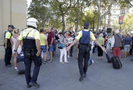 <p>Police officers tell members of the public to leave the scene in a street in Barcelona, Spain, Thursday, Aug. 17, 2017. Police in the northern Spanish city of Barcelona say a white van has jumped the sidewalk in the city's historic Las Ramblas district, injuring several people. (AP Photo/Manu Fernandez) </p>