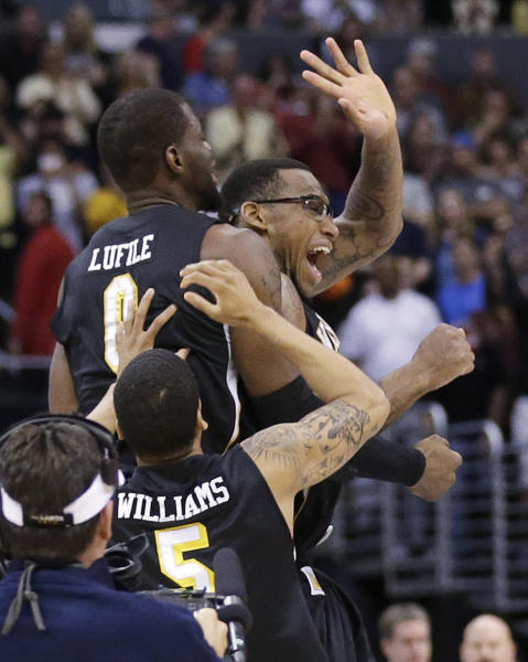 Wichita State's Carl Hall, right rear, Fred Van Vleet, left, and Demetric Williams celebrate their team's 70-66 win over Ohio State in the West Regional final in the NCAA men's college basketball tournament, Saturday, March 30, 2013, in Los Angeles. (AP Photo/Jae C. Hong)