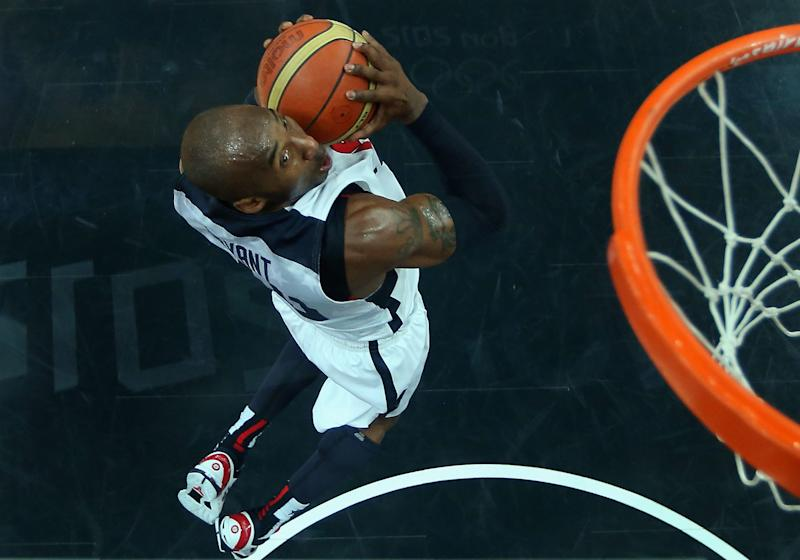 Kobe Bryant of the United States goes up for a slam dunk against Nigeria during a men's basketball preliminary round match at the 2012 Summer Olympics on Thursday, Aug. 2, 2012, in London. (AP Photo/Christian Petersen, Pool)