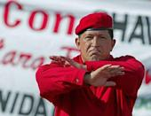 Venezuelan President Hugo Chavez gestures during a demonstration in Caracas 23 August 2003, celebrating his second three-year government. Chavez passed away on March 5, 2013 in Caracas after a long fight with cancer, Venezuelan Vice President Nicolas Maduro announced
