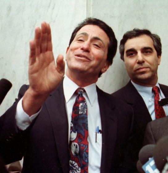 Former State Sen. Alan Robbins, left, talks to reporters, outside the Federal Courthouse in Sacramento, Calif., after pleading guilty to racketeering and income tax evasion in this Dec. 16, 1991 photo. Robbins was sentenced to five years in federal prison, later reduced to two-years, due to an FBI investIgation into corruption at the State Capitol. (AP Photo/Sal Veder)