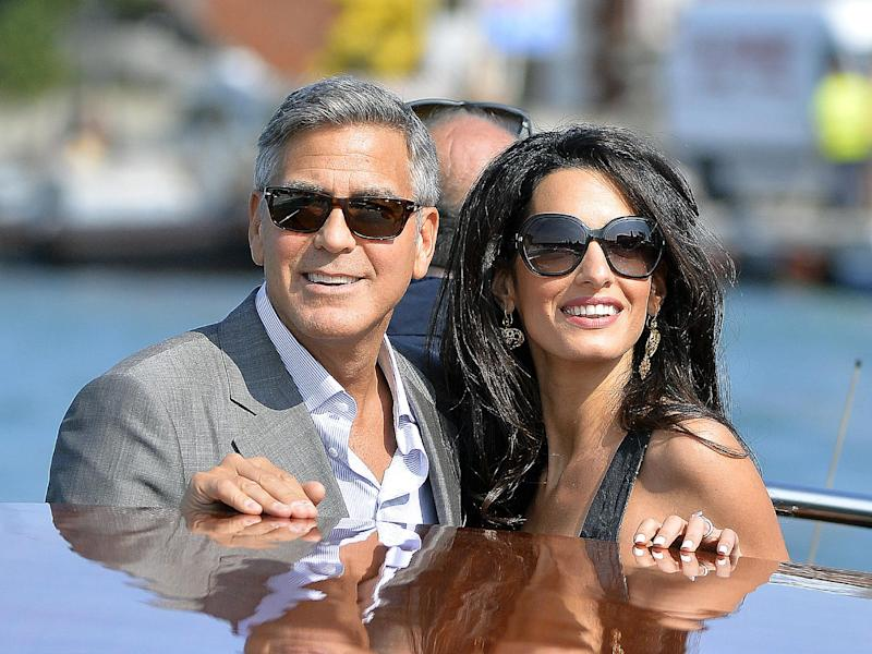 US actor George Clooney and his Lebanon-born British fiancee Amal Alamuddin arrive in Venice on September 26, 2014, on the eve of their wedding (AFP Photo/Andreas Solaro)