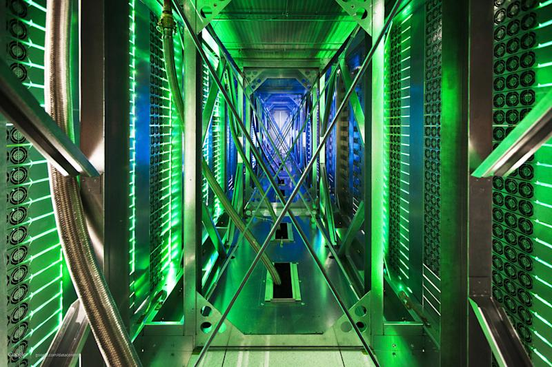 FILE - In this undated file photo made available by Google, hundreds of fans funnel hot air from the computer servers into a cooling unit to be recirculated at a Google data center in Mayes County, Okla. The green lights are the server status LEDs reflecting from the front of the servers. Eight major technology companies, including Google, Facebook and Twitter, have joined forces to call for tighter controls on government surveillance, issuing an open letter Monday, Dec. 9, 2013 to President Barack Obama arguing for reforms in the way the U.S. snoops on people. (AP Photo/Google, Connie Zhou, File)