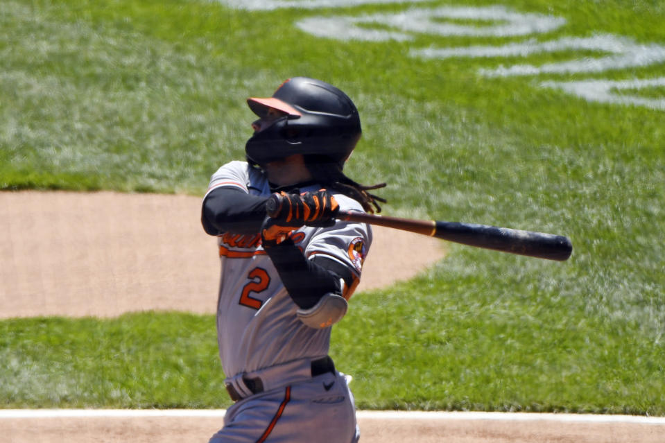 Baltimore Orioles' Freddy Galvis (2) hits a home run during the first inning in the first baseball game of a doubleheader against the Chicago White Sox, Saturday, May 29, 2021, in Chicago. (AP Photo/Matt Marton)