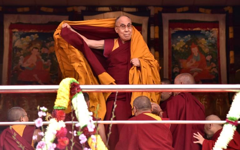Exiled Tibetan spiritual leader the Dalai Lama adjusts his shawl as he arrives to deliver teachings to Buddhist followers at the Yiga Choezin ground in Tawang  near the India-China border