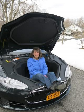2013 Tesla Model S electric sport sedan on delivery day, with Lisa Noland sitting in the front trunk
