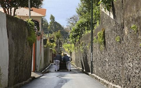 Toboggan run in wicker basket through the streets of Funchal - Credit: iStock