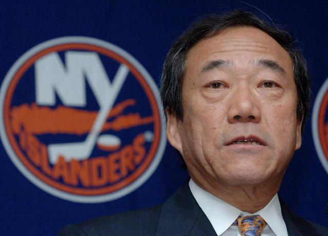 "FILE - In this Jan. 12, 2006, file photo, New York Islanders' owner Charles Wang speaks during a news conference in Uniondale, New York. The Islanders have announced that the team is being sold to a former Washington Capitals co-owner and a London-based investor. In a statement Tuesday, Aug. 19, 2014, the team says a group led by former Capitals co-owner Jon Ledecky and investor Scott Malkin has reached an agreement to buy a ""substantial"" minority interest in the team. (AP Photo/Henny Ray Abrams, File)"