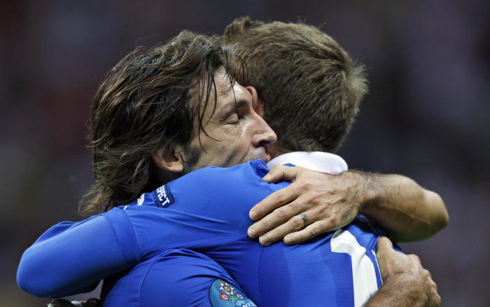 Italy's Andrea Pirlo, left, hugs teammate Daniele De Rossi after winning the Euro 2012 soccer championship semifinal match between Germany and Italy in Warsaw, Poland, Thursday, June 28, 2012. (AP Photo/Michael Sohn)
