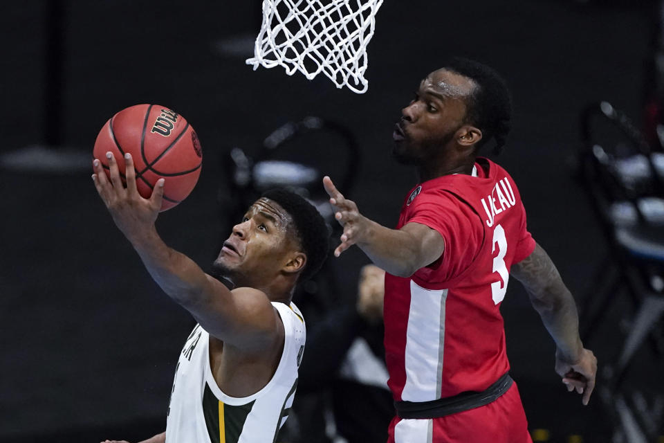 Baylor guard Jared Butler, left, drives to the basket ahead of Houston guard DeJon Jarreau (3) during the first half of a men's Final Four NCAA college basketball tournament semifinal game, Saturday, April 3, 2021, at Lucas Oil Stadium in Indianapolis. (AP Photo/Darron Cummings)