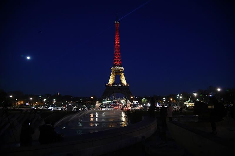 Global landmarks from the Eiffel Tower in Paris to Berlin's Brandenburg Gate were lit up in the black, yellow and red of the Belgian national flag in solidarity (AFP Photo/Lionel Bonaventure)