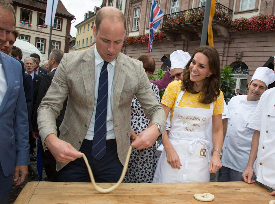 HEIDELBERG, GERMANY - JULY 20:  (NO UK SALES FOR 28 DAYS FROM CREATE DATE) Prince William, Duke of Cambridge and Catherine, Duchess of Cambridge make pretzels as they tour a traditional German market in the Central Square during an official visit to Poland and Germany on July 20, 2017 in Heidelberg, Germany.  (Photo by Pool/Samir Hussein/WireImage)