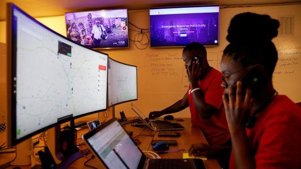 Dispatchers for the Rescue.co ambulance service look at computer screens in Nairobi.