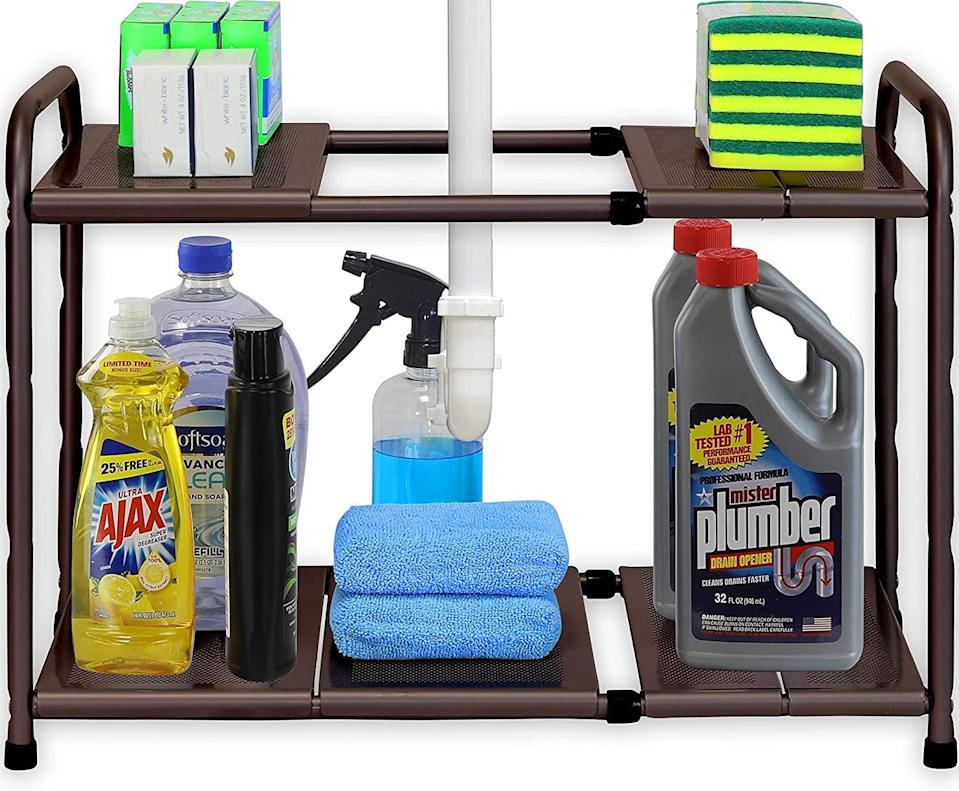 <p>Get this <span>SimpleHouseware Under Sink 2 Tier Expandable Shelf Organizer Rack</span> ($25) if your cabinet is on the larger side. It comes in bronze, silver, and white.</p>