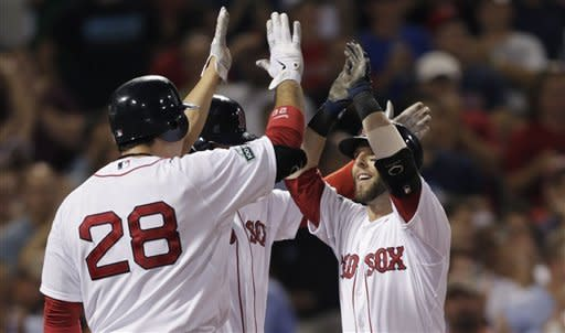Boston Red Sox's Dustin Pedroia, right, is congratulated by teammates after his three-run home run off Los Angeles Angels pitcher C.J. Wilson during the second inning of a baseball game at Fenway Park in Boston, Thursday, Aug. 23, 2012. (AP Photo/Charles Krupa)