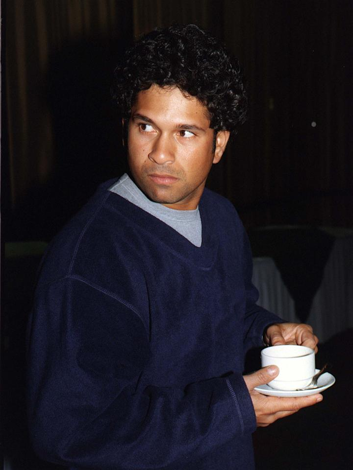 AUCKLAND, NEW ZEALAND - DECEMBER 04:  Indian cricket's batting star Sachin Tendulkar enjoys a cup of tea at the Centra Airport Hotel after the Indian Cricket team arrived in Auckland to kicj off their tour.  (Photo by David Hallett/Getty Images)