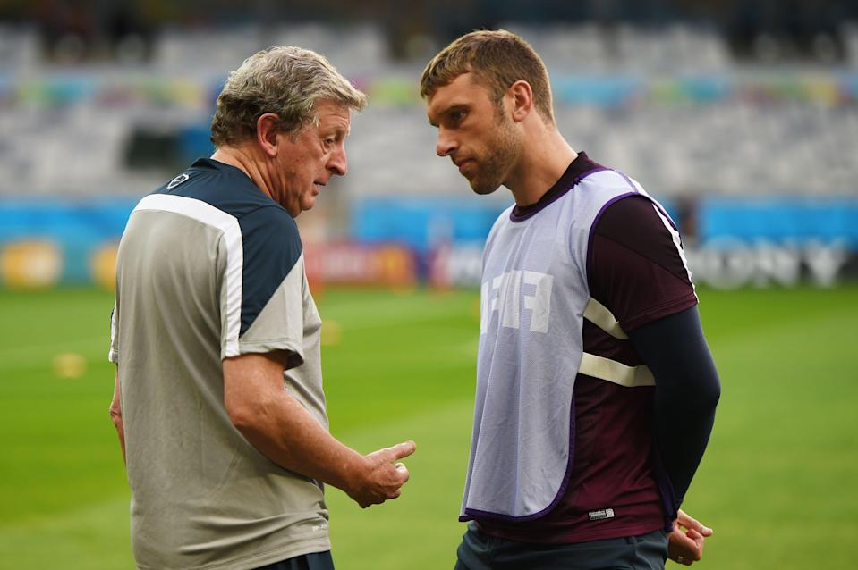 Roy Hodgson and Rickie Lambert in conversation at the 2014 World CupThe FA via Getty Images