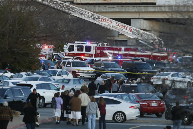 People mill around in the parking lot at Penn Square Mall after police respond to a report of a shooting Thursday, Dec. 19, 2019, in Oklahoma City. One person was shot at the mall during what police are calling a disturbance involving two people. (AP/Sue Ogrocki)