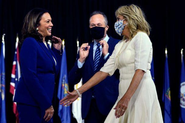 PHOTO: Sen. Kamala Harris and her husband Douglas Emhoff greet Jill Biden, wife of Democratic presidential candidate former Vice President Joe Biden, after a campaign event at Alexis Dupont High School in Wilmington, Del., Aug. 12, 2020. (Carolyn Kaster/AP)